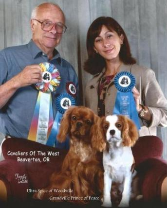 Ultra Spice of Woodville (Best Ruby in Show) and Grandville Prince of Peace (Best Puppy Dog in Show)